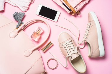 Woman fashion accessories pink shoes, handbag, smartphone and pe