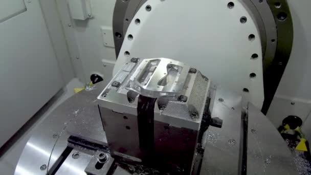 Metal part installed in machine holders. Work space of the CNC milling center.