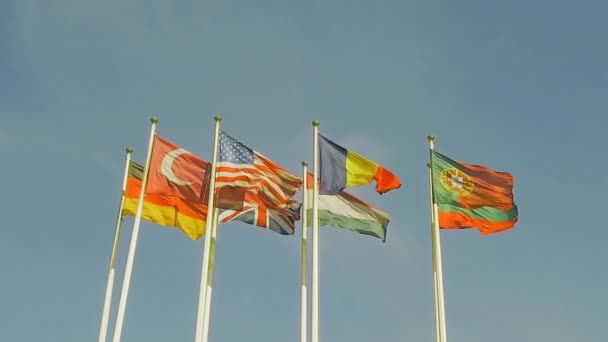 A lot of flags of different countries, flags flap in the wind. Slow motion