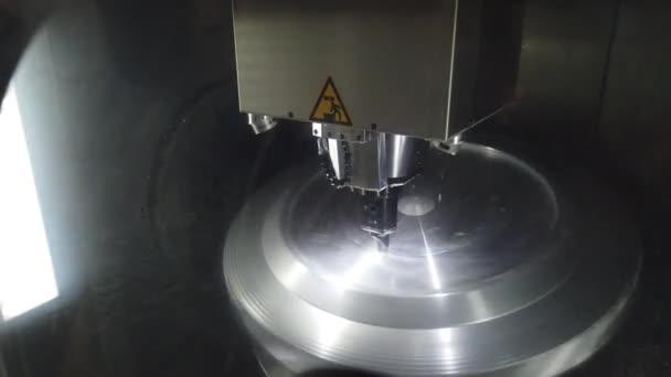Precision milling CNC machine tool makes part.