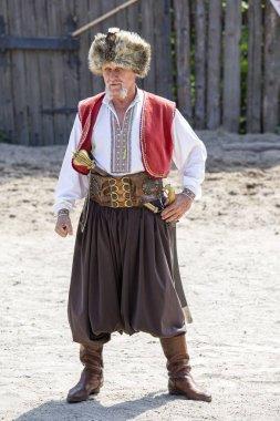 KHORTYTSIA, UKRAINE - JUNE 22, 2013 : Cossack festival at the Zaporozhye Sech in island Khortytsia, Ukraine. Traditional clothes of Cossack man