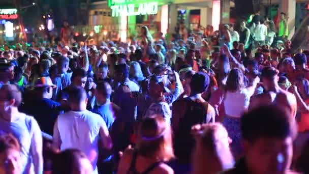 KOH PHANGAN, THAILAND - MARCH 02, 2018 : Girls and guys participate in Full Moon party in island Koh Phangan, Thailand. Event now attracts anywhere about 30,000 party-goers on a normal month