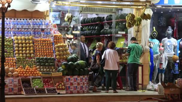 SHARM EL-SHEIKH, EGYPT -  MAY 14, 2018: Egyptian food shops for tourists in the old city market at night in Sharm El Sheikh, South Sinai, Egypt