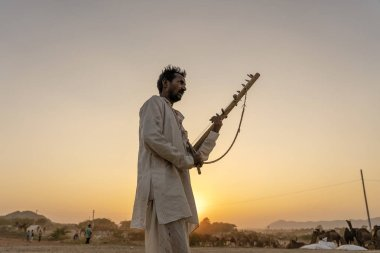 PUSHKAR, INDIA - NOVEMBER 12, 2018 : Unidentified indian musician at the attended the annual Pushkar Camel Mela near holy city Pushkar, Rajasthan, India