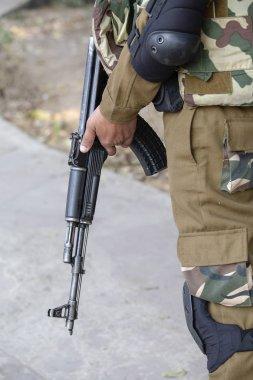 Warrior holding a automatic machine gun. New Delhi, India. Close up stock vector