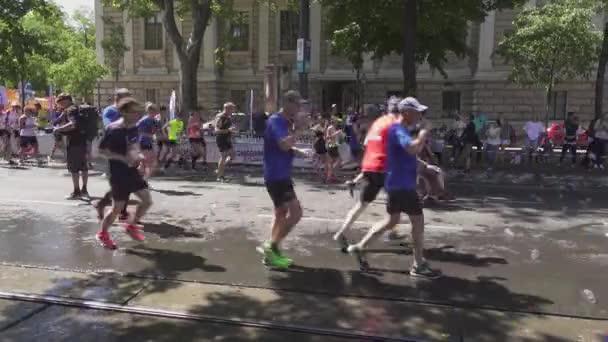 Marathon runners slow down to drink water