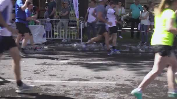 Plastic cups for water under the feet of marathon runners