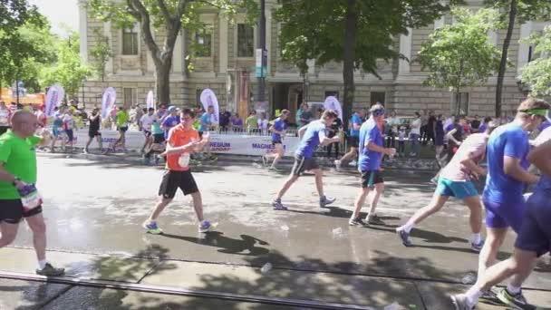 Athletes at the marathon drink water slow motion