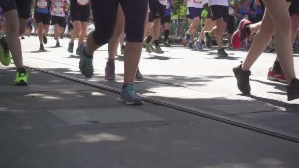 People running on tram tracks at the marathon Slow Motion