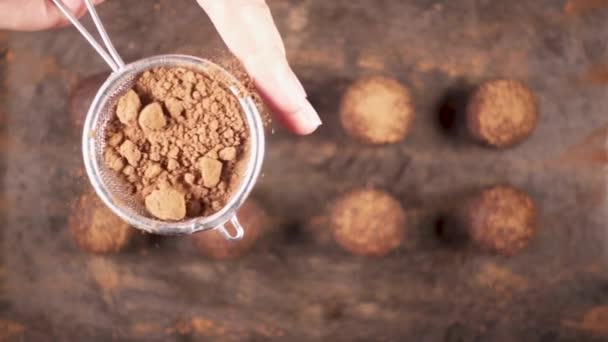 Sprinkle candy cocoa powder from a small spoon-sieve