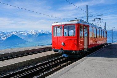 Famous electric red tourist swiss train on Rigi mountain,Switzer