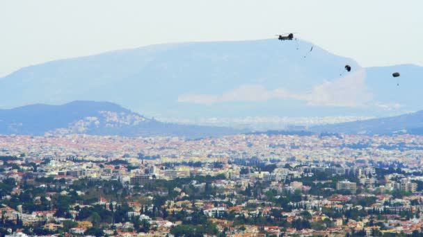 ATHENS, GREECE - 05.03.2018: Chinook Helicopter Launches A Group Of Paratroopers During A Training Exercise Over The Tatoi Military Airport At Dusk.