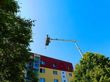 Templin, Brandenburg district Uckermark / Germany - July 24, 2019: Antenna work with a hoist on the house