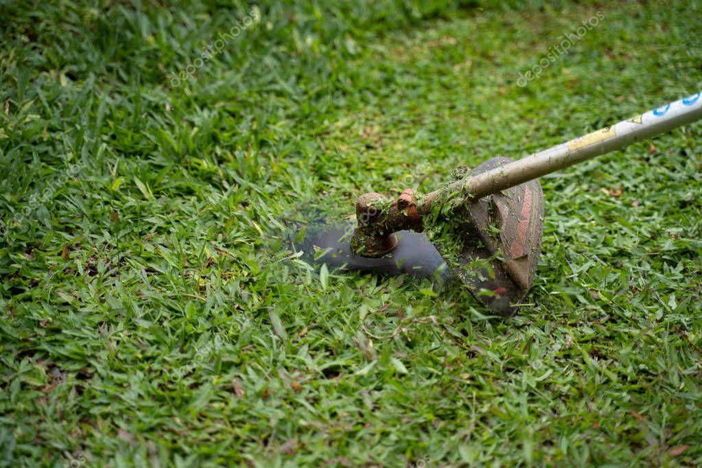 man mowing his own garden