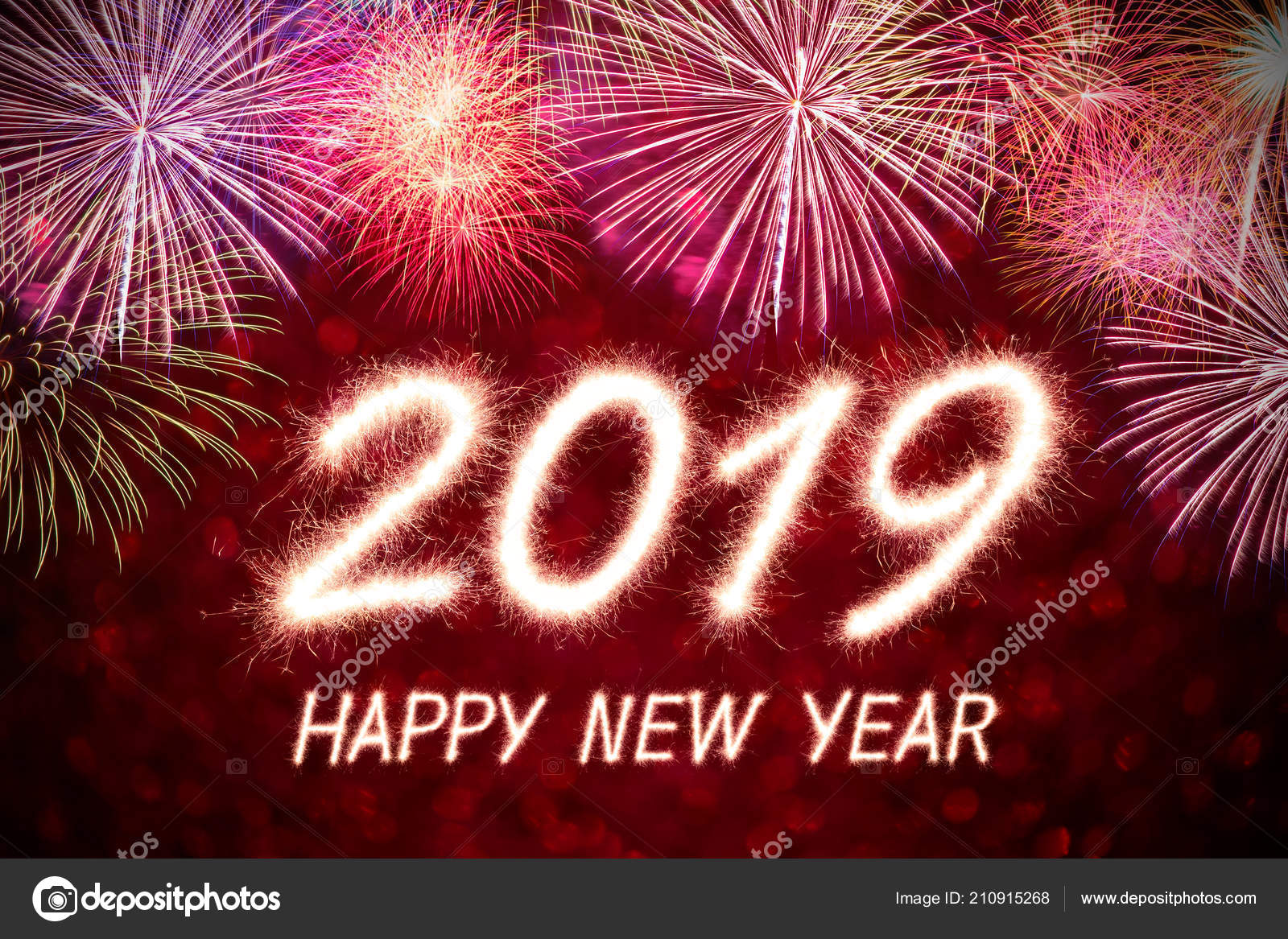 happy new year 2019 written sparkle firework firework background stock photo