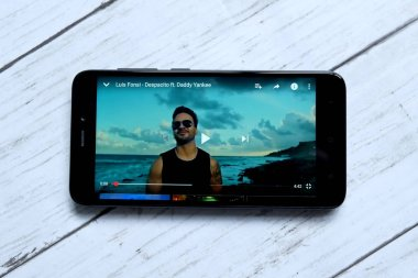 Kuala Lumpur,Malaysia - January 28th, 2018 : Top view of smartphone playing Despacito music video.Despacito s a single by Puerto Rican singer Luis Fonsi featuring Puerto Rican rapper Daddy Yankee.