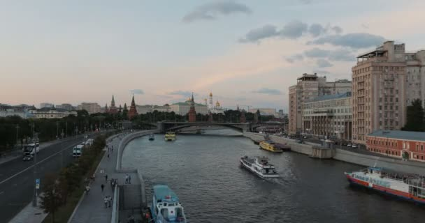 Tourist ships navigate in Moscow river Timelapse. View of Moscow Kremlin and Moskow River, Moscow, Russia.