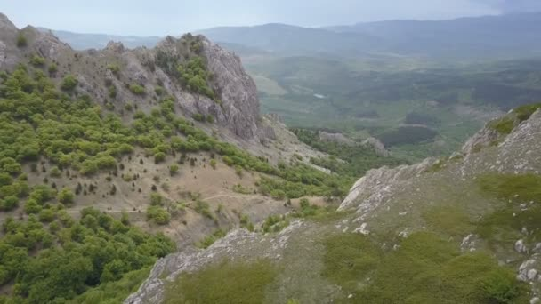 Aerial. Flying over Mountains, rocks and forests. Amazing view of Crimea