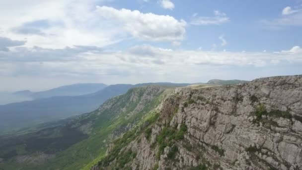 Amazing Aerial view of rocks, forests and sea in Crimea. Flight along a cliff in Crimean Mountains.