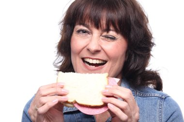 Adult woman with sandwich close up