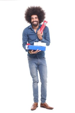 Happy black man with gift boxes
