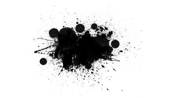 Černé inkousty kapky na bílém pozadí
