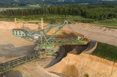 Scenic aerial view of coal mine industry and heavy equipment on quarry