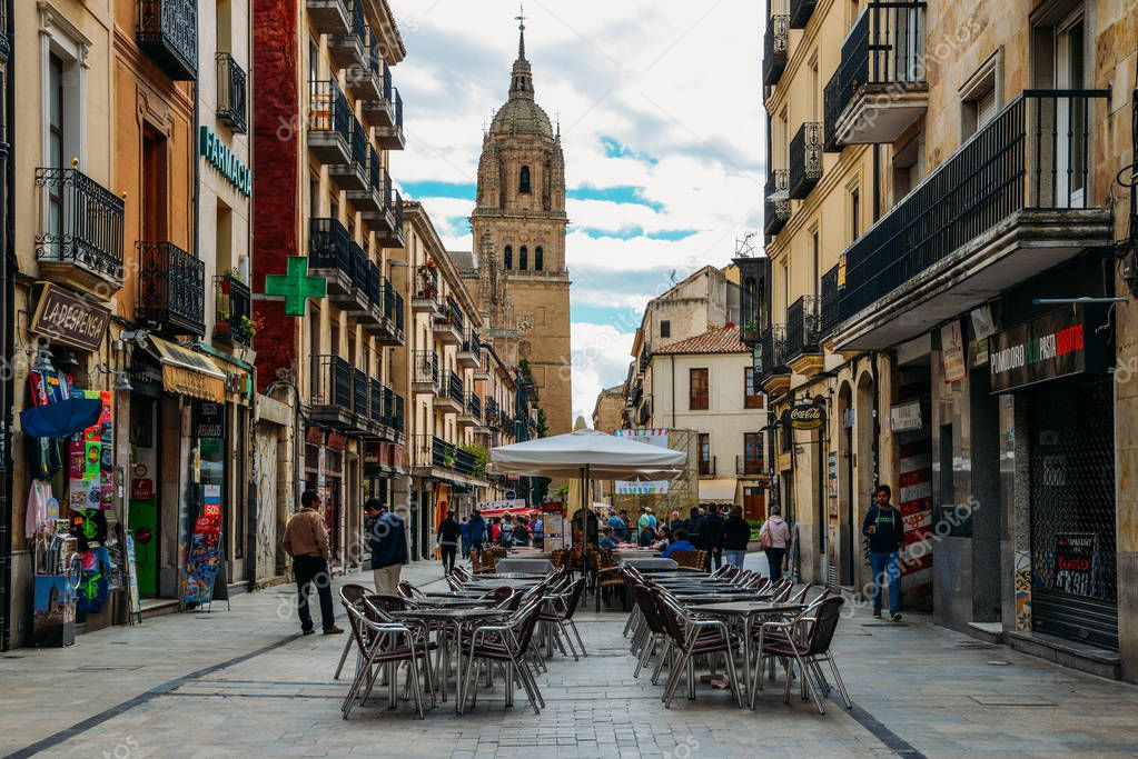 A pedestrian street leading to the Old Cathedral in the historic centre of Salamanca, Castilla y Leon, Spain