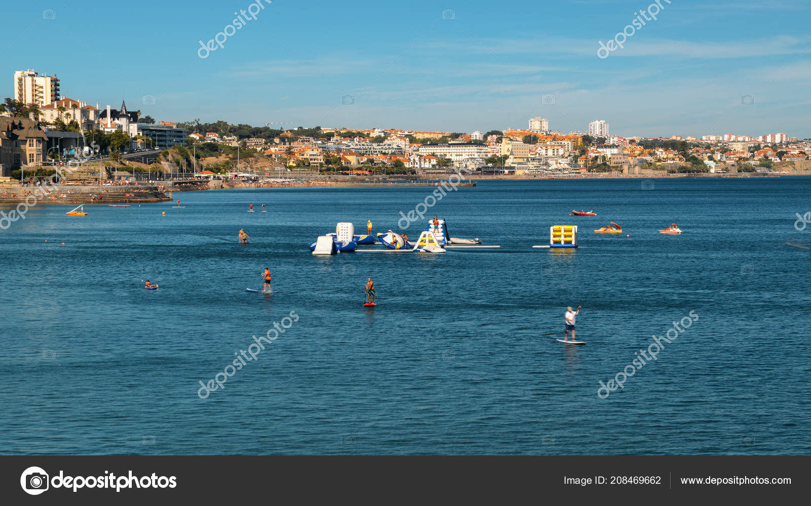 95dc9352d Persons enjoying stand up paddle at Cascais Bay during the summer ...