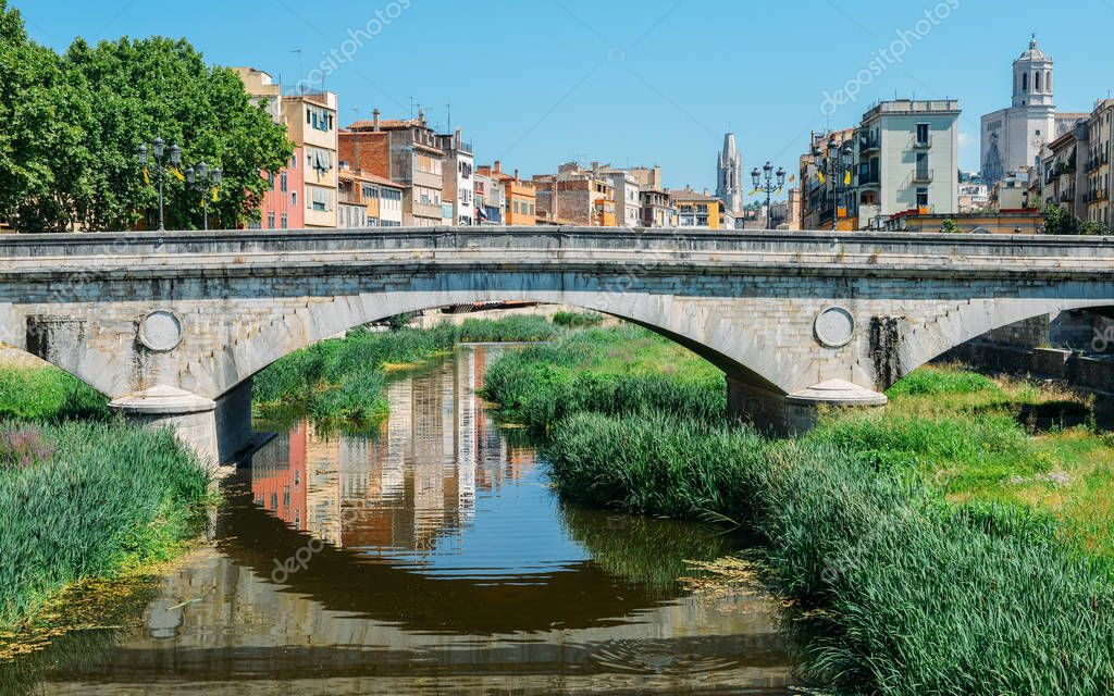 Girona - town in Catalonia, Spain. Onyar River bridge and beautiful, colorful mediterranean architecture. Prominent cathedral.
