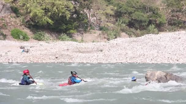 Rishikesh, India - April 2019. Rafting and kayaking on Ganga river near Rishikesh, Uttarkhand, India