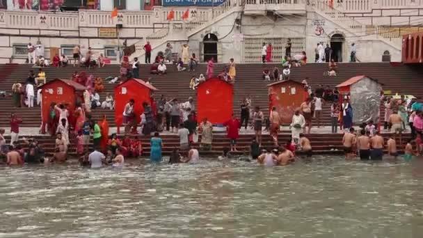 Haridwar, India - Circa April 2019. People on the Ganga river embankment, Har Ki Pauri. Har Ki Pauri is a famous ghat on the banks of the Ganges in Haridwar.