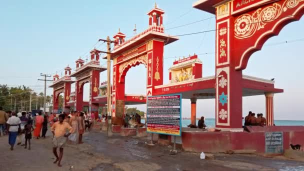 Rameshwaram, India - Circa December 2019. Hindu people people bathing in the Arabian Sea before entering the temple