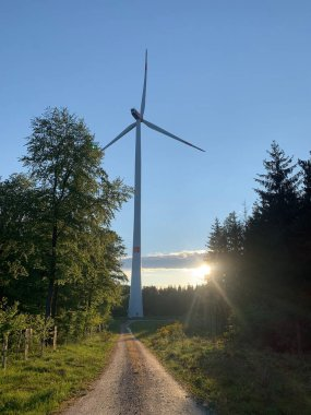 eco-friendly windmill with spinning blades generates electricity, the concept of modern global technologies, environmental protection