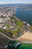 Aerial view of Fort Scratchley and Nobbys Beach - Newcastle Australia. Fort Scratchley was an important military base in WW2 protecting the industrial city of Newcastle. It now is a tourist attraction and overlooks the beautiful Nobbys Beach