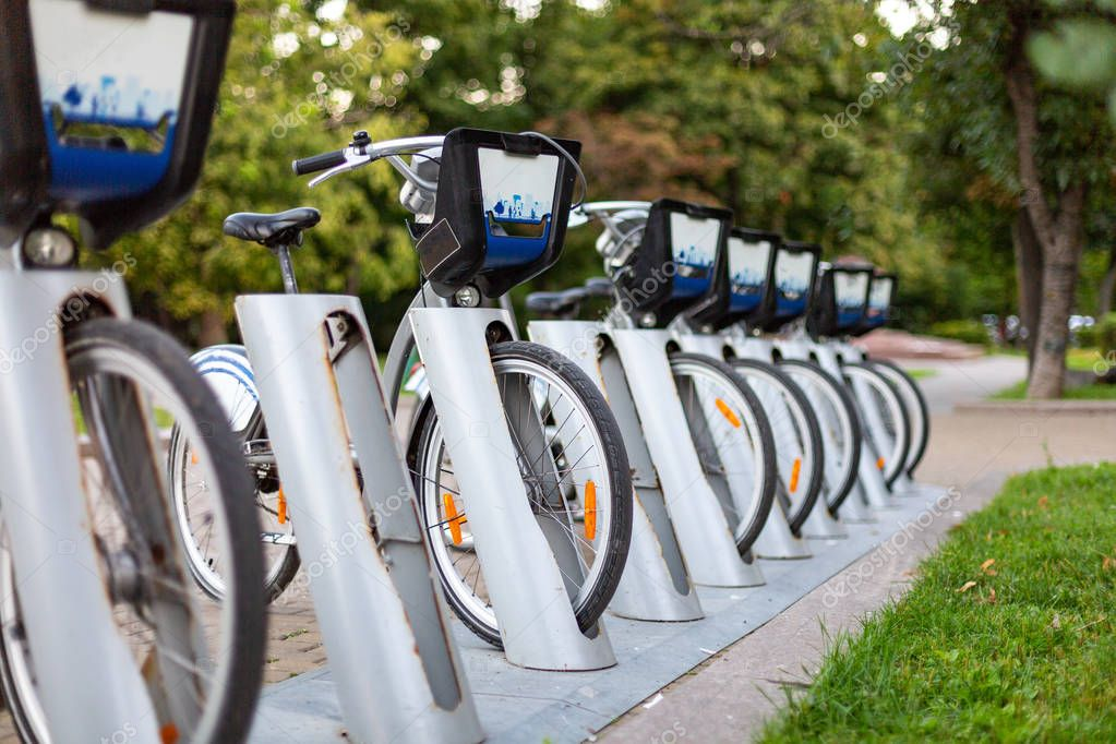 Bicycle rental station on city street.