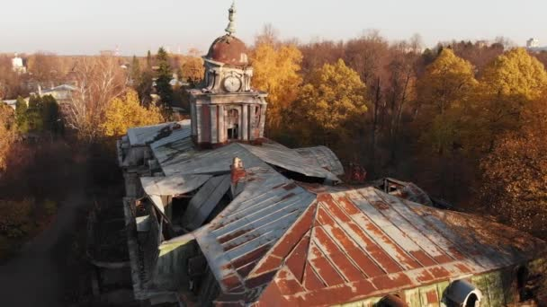 Aerial view on abandoned ruined castle and park. Autumn color footage in sunset light
