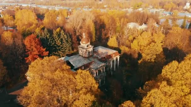 Aerial view on abandoned ruined castle and park. Autumn color footage in sunset light.