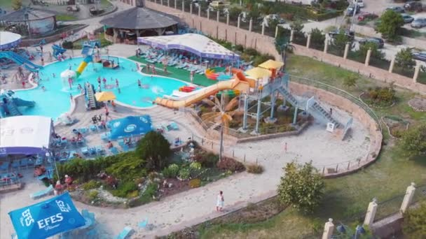 Russia, Sochi 01, August 2018. Beautiful water park, shot from above. Summer rides, recreation for people with children. Colored water slides, summer vacation.