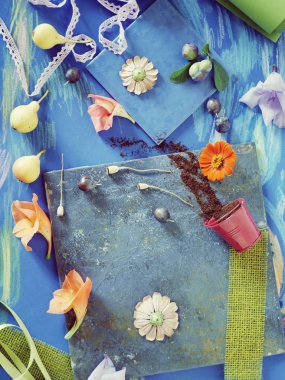 Seasonal summer composition of fruits, flowers and decor on a blue background, top view