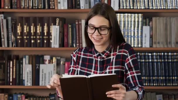 Teenager enjoy to read book at background shelving