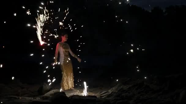 Woman juggling flame torches at outdoor fireshow