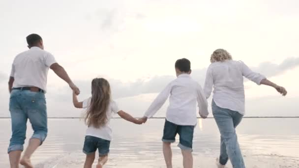 Fun happy family walks holding hands children, summer vacation together outdoors