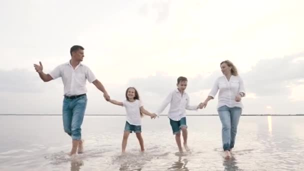 Excited happy fun family walks, talks together, vacation outdoors holding hands