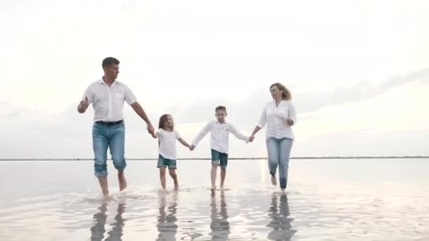 Happy fun excited family together walks holding children hands, run outdoors joy