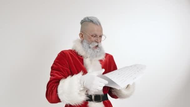 Šílený Santa Claus číst dopis, seznam přání dětí, tradiční sváteční překvapení