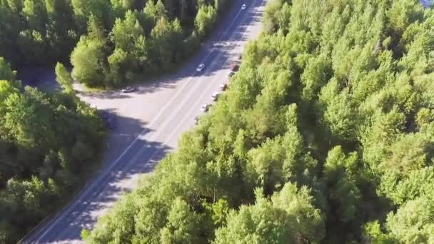 Aerial view of cars traffic on summer forest highway