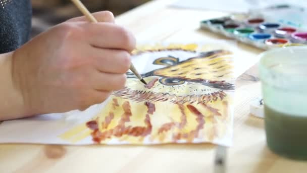 Artists hand with a brush