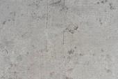 Detailní pohled staré grey zvětralé betonové strukturované pozadí