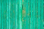 starý poškrábaný zelený dřevěný plot pozadí